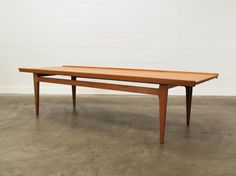 Finn Juhl's famous 500 series coffee table in solid teak (1958). Manufactured by France and Son of Denmark.