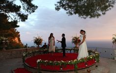 this fairytale italian wedding took place in a tiny park overlooking the sea in a remote location.