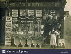 Historic archive image of shopkeeper outside Grocer's Shop c1910s Stock Photo, Royalty Free Image: 131373610 - Alamy