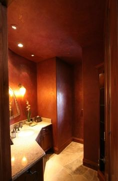red venetian plaster with gold wax glaze