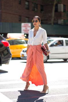 Beautiful shot of a stunning coral maxi, simple and perfect for summertime street style!