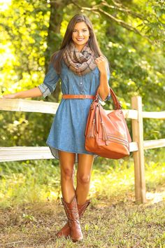 Shop this look on Lookastic:  http://lookastic.com/women/looks/scarf-casual-dress-knee-high-boots-belt-tote-bag/4402  — Tan Plaid Cotton Scarf  — Blue Denim Casual Dress  — Brown Leather Knee High Boots  — Orange Leather Belt  — Orange Leather Tote Bag