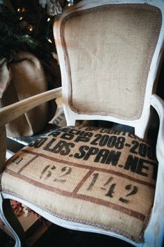 A living room side chair covered in burlap.
