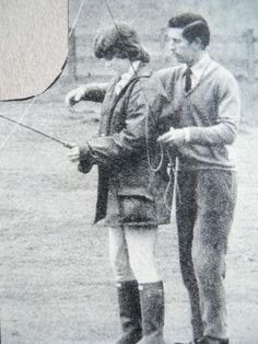 Charles helping Diana to fish