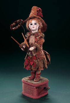 """French Musical Automaton """"Bebe Jeu de Grace"""" by Leopold Lambert. circa 1886,the automaton appeared in the Lambert catalog as #8 Bebe Jeu de Grace. She is holding two maple-wood sticks (baguettes) with velvet-covered handles and,positioned on a wire frame in front of her so as to appear to be flying in the air,is a chenille-velvet-covered hoop (coronne). http://Theriaults.com/"""