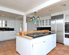 photo of beige white kitchen with floor tiles quarry tiles tiles panelled ceiling