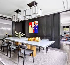 Metallic accents Modern homes are famous for their primarily black, white, and gray color schemes, but often break up the hues with a healthy dose of lacquer and sheen. Here, golden objets coordinate with the similarly hued legs of a dining table by Martin Szekely.