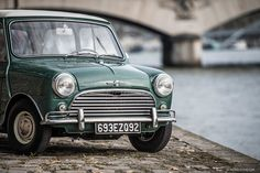 Find out how the beloved Mini Cooper, before earning its reputation as a Giant Killer, began life as a revolutionary marvel intended to drive bubble cars off the road. Classic Mini, Classic Cars, Austin Seven, Cooper Car, Moto Car, Wedding Initials, S Car, Old World Charm, Car Wrap