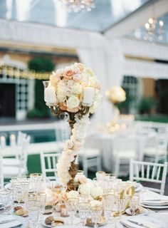Glamorous floral wrapped tall centerpiece: http://www.stylemepretty.com/2016/04/07/an-italian-garden-wedding-fit-for-a-princess/ | Photography: Judy Pak - http://judypak.com/
