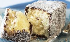 This twist on the classic lamington uses a condensed milk caramel to sandwich the sponge pieces together before rolling in chocolate icing and coconut. Chocolate Icing, Chocolate Caramels, Vegetarian Bake, Australia Day, Golden Syrup, Cocoa, Sandwiches, Baking, Qoutes