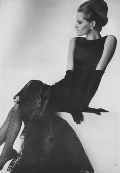 Veruschka, September Vogue 1964    Wearing a narrow lace black dress with a stir of a ruffled hemline of Dognin lace.