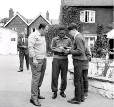 Pele signing autographs for fans during the 1966 World Cup in England.