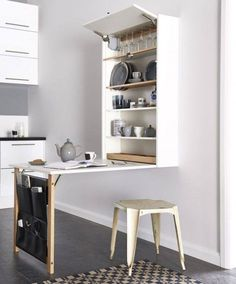 Drop-down kitchen table with storage for dishes and tableware behind it