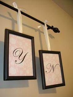 Picture frames ... I would really like to use this idea, but I would use the see through...all glass frames so popular now so that the monogram would look like it is floating in a black frame