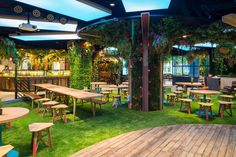 Experience all the seasons with immersive connected LED lighting from Signify, formerly Philips Lighting at multi-cuisine restaurant in Singapore. Singapore Garden, Outdoor Dining, Outdoor Decor, Cool Cafe, Beer Garden, Garden Theme, Garden Planning, Store Design, Organic Gardening
