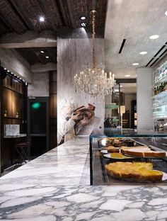Industrial chic patisserie in Thessaloniki by arkteam. Located in a listed building in the centre of Thessaloniki, Greece, the store belongs to Terkenlis, a historic and famous patisserie and bakery brand.