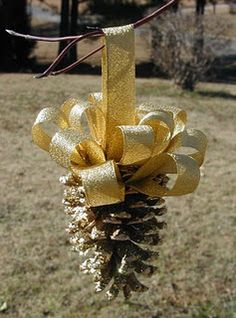Pinecones, gilded, with a huge, splashy bow...perfect!