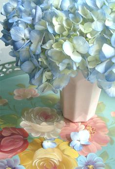 Flowers on a pretty flowered tablecloth- because you can never have too many flowers!