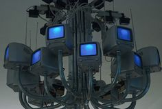 """Ian Burns  """"The End of an Era,"""" 2007   16 TV chandelier receiving live feed from camera obscura bulb projection"""