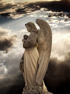 Beautiful angel statue with a brilliant sky backdrop