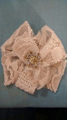 Lace hairpiece made from hemmed scrap of mother of the bride dress