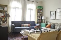 Jordan Ferney's former living room in SF - tight seating making the most of the space and books everywhere.