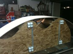 Applying bendable plywood to the front and back.