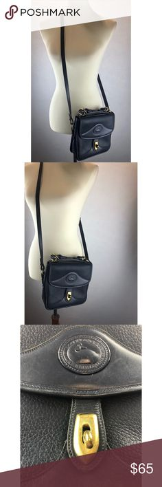 Vintage authentic Dooney & Bourke crossbody Pre owned in really good condition  All weather leather purse The inside is in great condition  Navy blue  The hardware (brass) has a few scratches , purse is still in great condition , has a few minor flaws , shown in pics  Great every day purse Dooney & Bourke Bags Crossbody Bags