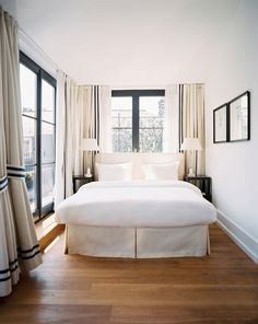 Lonny Magazine - bedrooms - natural, linen, slipcovered, headboard, bed skirt, black, nightstands, crystal, column, lamps, natural, linen, drapes, black, ribbon trim, bed in front of window, beds in front of window, headboards in front of window,