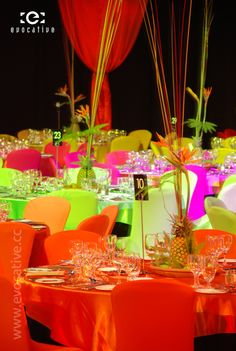 Carnival theme with alternating bright coloured chair covers and centre pieces made from pineapples and bird of paradise flowers, at the Retravision Gala Dinner. #EventPhotography