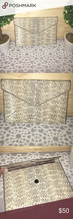 Rebecca Minkoff snakeskin clutch Rebecca Minkoff snakeskin clutch with zipper trim measuring 11x7.5 Rebecca Minkoff Bags Clutches & Wristlets