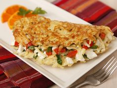 An omelet made from Hashbrowns filled with eggs, diced tomatoes, spinach and feta cheese. A smart & simple start to the morning before heading off to school!