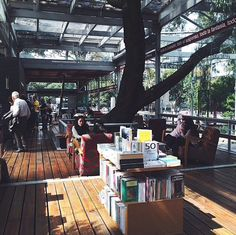 """""""There are many Porrúa bookstores in Mexico City, but this is special, this one is inside Chapultec park, the biggest park in the city. It has a lovely view, a big terrace just in front of the main lake and there are many trees that've been there since the bookstore was build. And…of course there are thousands of books! Perfect spot to spend a rainy or sunny day having a coffee, reading a great book, and feeling outside of this noisy city!"""" Photo and caption by @paula.guerra…"""