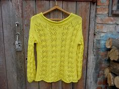 Another gorgeous knitted creation! Plus, Elena donates 10% from her sales to a Ukrainian school. Hand Knit Lemon Yellow Drop Sleeves Sweater by TaitallasHandmade