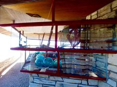 Clinton Della Walker Residence, 1951, Frank Lloyd Wright, Carmel-by-the-Sea, California;  Steel-framed inverse stepped windows in the hexagonal shaped living room meet at a point and look like a ship's prow.