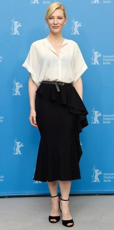 Cate Blanchett Cate Blanchett hit the Cinderella photocall at the Berlinale International Film Festival in loose white blouse tucked into a belted black ruffled shin-grazing skirt, with black ankle-strap peep-toes.