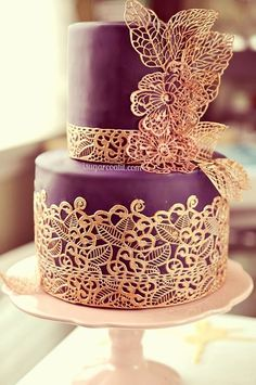 Gorgeous purple wedding cake with intricate lace design