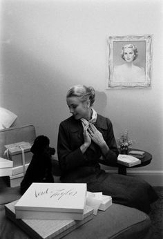 Grace Kelly and her poodle, Oliver, at home in Philadelphia before moving to Monaco.