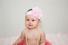 6 month photos with pink bow, tutu and pearls! #babyphotography #6monthphotos #prettyinpink
