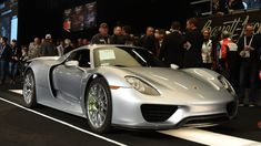 Four Porsche 918 Spyders went to auction at Scottsdale for two sales and two DNFs. The...