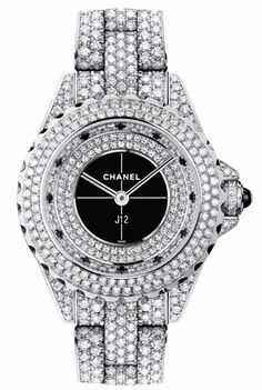 Chanel's famed J12 watch collection steps up in style this holiday season. The J12 Exclusive Edition is a 29mm Quartz and is set in white gold and features a full pavé diamond face and band.