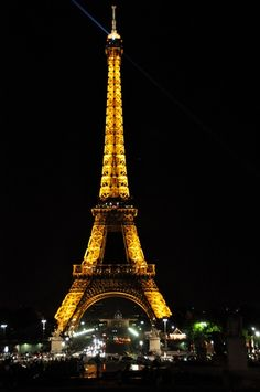 The Eiffel Tower lit at night.