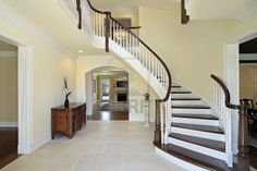 Foyer with curved staircase in new construction home Stock Photo