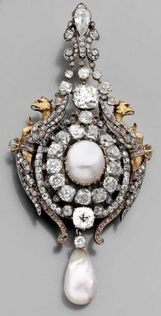 Diamonds And Pearls pendant. Some sort of creatures are in gold.
