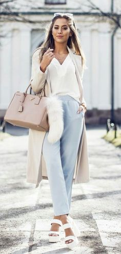 Street Style, March 2015 Just The Design: Kenza Zouiten is wearing a creme Ginatricot coat and blouse with baby blue high waisted trousers and white NYL heels. Idea for pantone 2016 color serenity and good outift for type 2 dyt Baby Blue Pants, Baby Blue Shirt, Light Blue Pants, Fashion Mode, Look Fashion, Fashion Outfits, Womens Fashion, Net Fashion, Girl Outfits