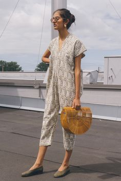 You'll seriously want to wear this bad boy every day. The Miranda Bennett Everyday jumpsuit is reinterpreted in a custom woven linen with a hint of lurex and a tonal, screen printed geometric pattern, designed by artist Alyson Fox. Wear it with a pair of glove shoes and a statement bag. Garmentory Exclusive. Karen is a 31 Bust | 24 Waist | 35.5 Hips | Height 5'10. She is wearing a size OS. She collects vintage band t-shirts in her spare time. Please note: Ship out in 1 to 3 business d...