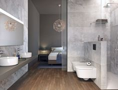 Un murete bajo aisla la ducha y sirve de soporte al inodoro y bidé, ambos de la col. Inspira Round, al igual que los lavabos, desde 314 €/cu. En la ducha, plato Helios, desde 456 €, y columna, Even-T Round, desde 678 €. Todo de Roca.