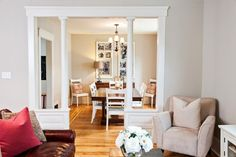 Love the columns and change in direction in the flooring -- Nicole Curtis removed the old carpet to reveal beautiful original pine floors. The refinished floors plus new furnishings work together to make the living and dining rooms comfortable, functional and stylish.