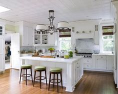 Beautiful open kitchen living room design with white kitchen cabinets, calcutta marble counter tops, farmhouse sink, cafe au lait walls paint color, white kitchen island and Grosvenor single pendants. Description from pinterest.com. I searched for this on bing.com/images