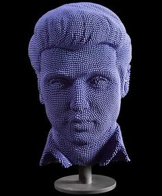 Elvis bust by David Mach, a scottish sculptor and installation artist, using no less than 50,000 matchsticks.